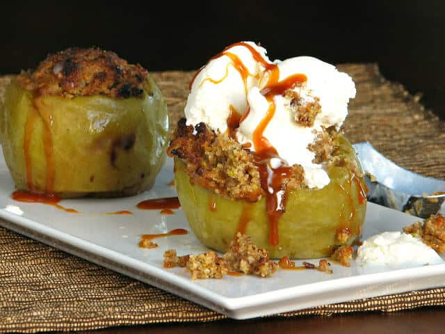 Baked apples with whipped cream and caramel sauce