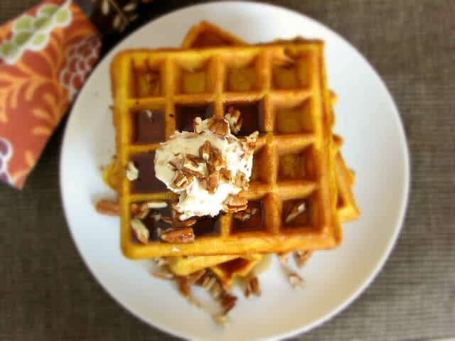 Light and fluffy pumpkin waffles drenched in maple bacon butter