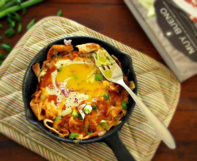 Chilaquiles rojos and egg on a bed of crunchy tortilla chips