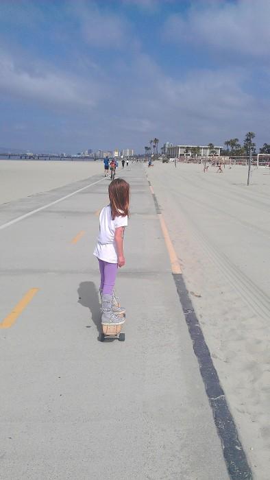 Cruising on her skateboard