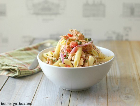 Poached salmon pasta salad in a garlic dressing