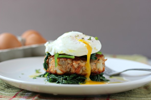Salmon fish cakes with a poached egg and wilted spinach