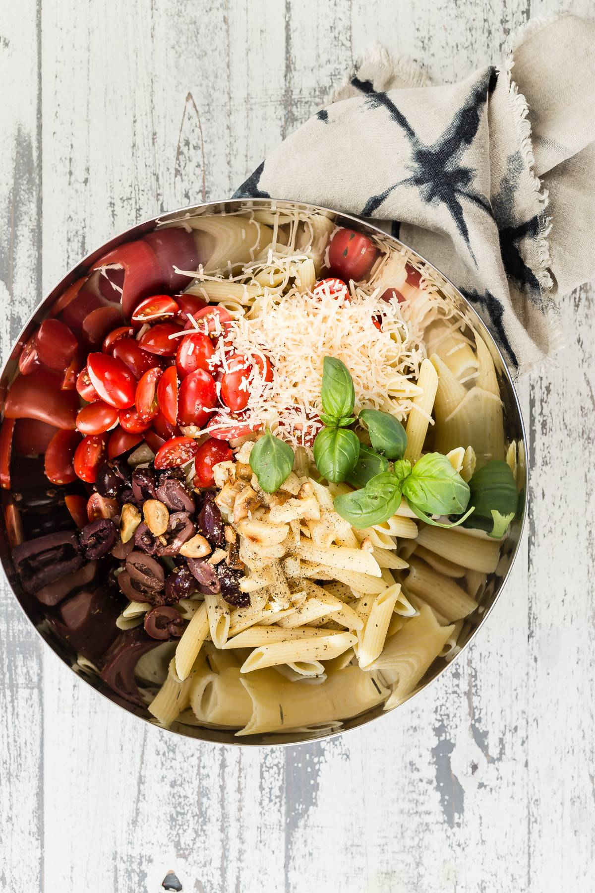 Pomodoro Pasta salad ingredients in a bowl