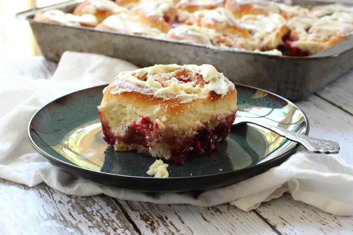 Triple Berry Breakfast Buns with White Chocolate Cream Cheese Frosting