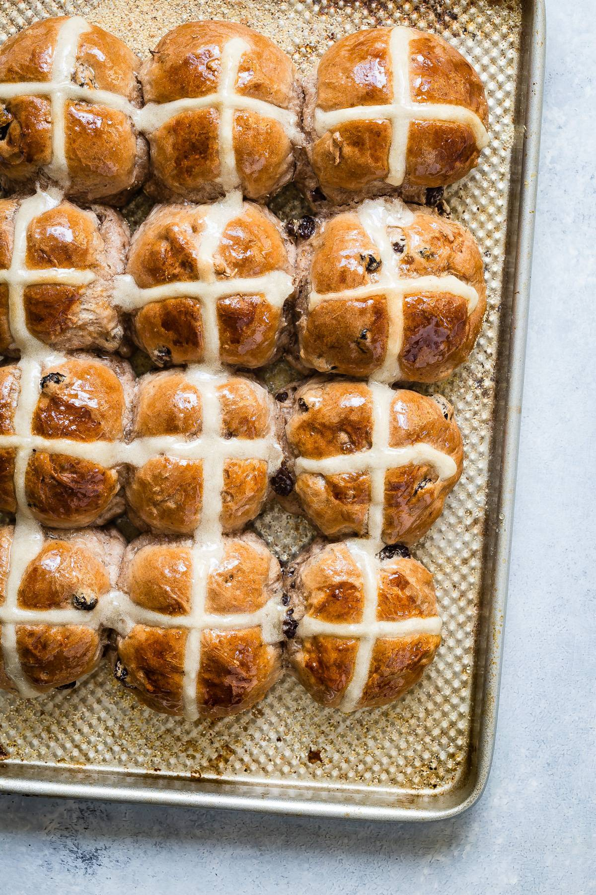 pan of Easter hot cross buns with sweet glaze on top