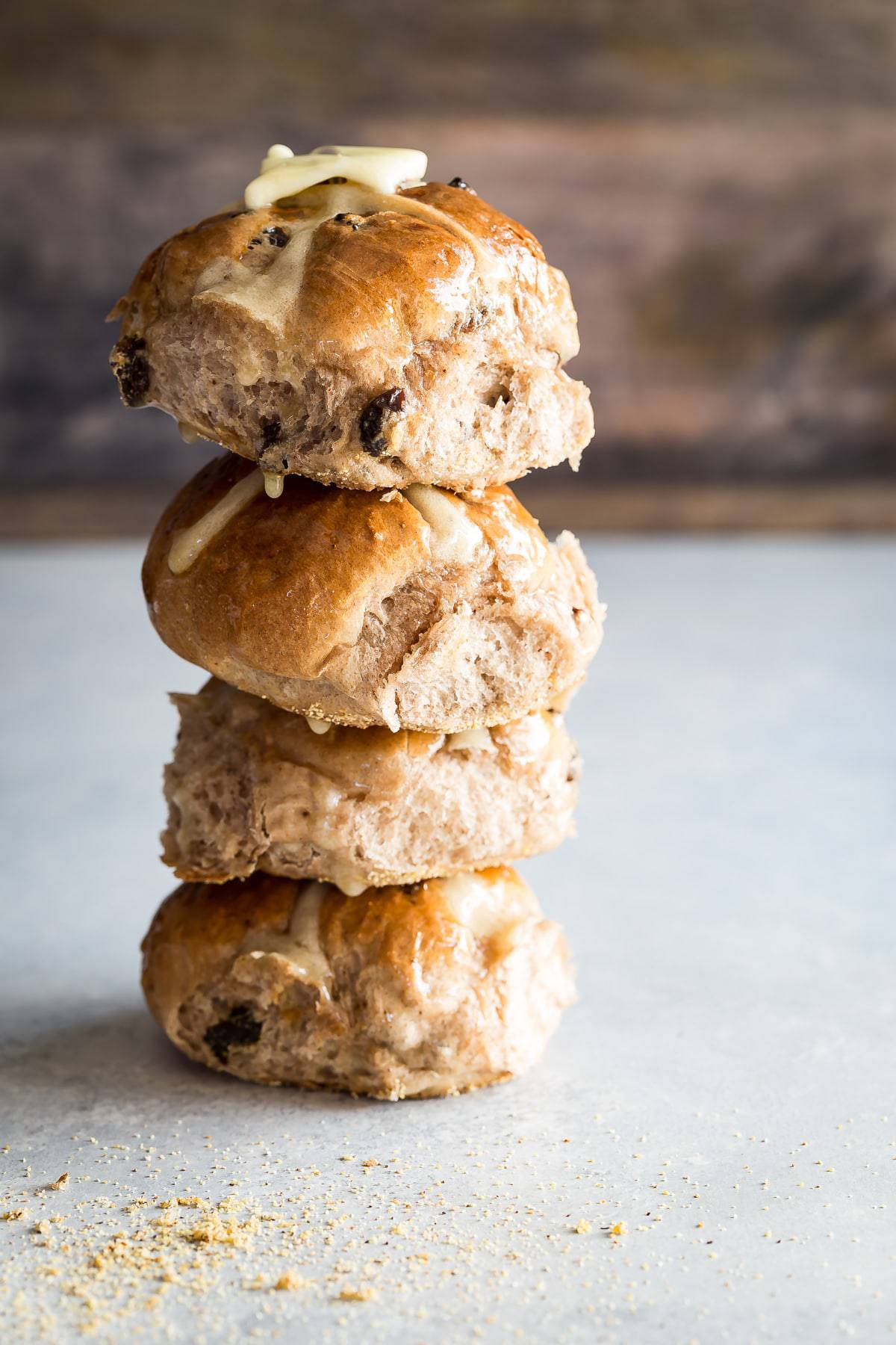 tall stack of 4 homemade hot cross buns