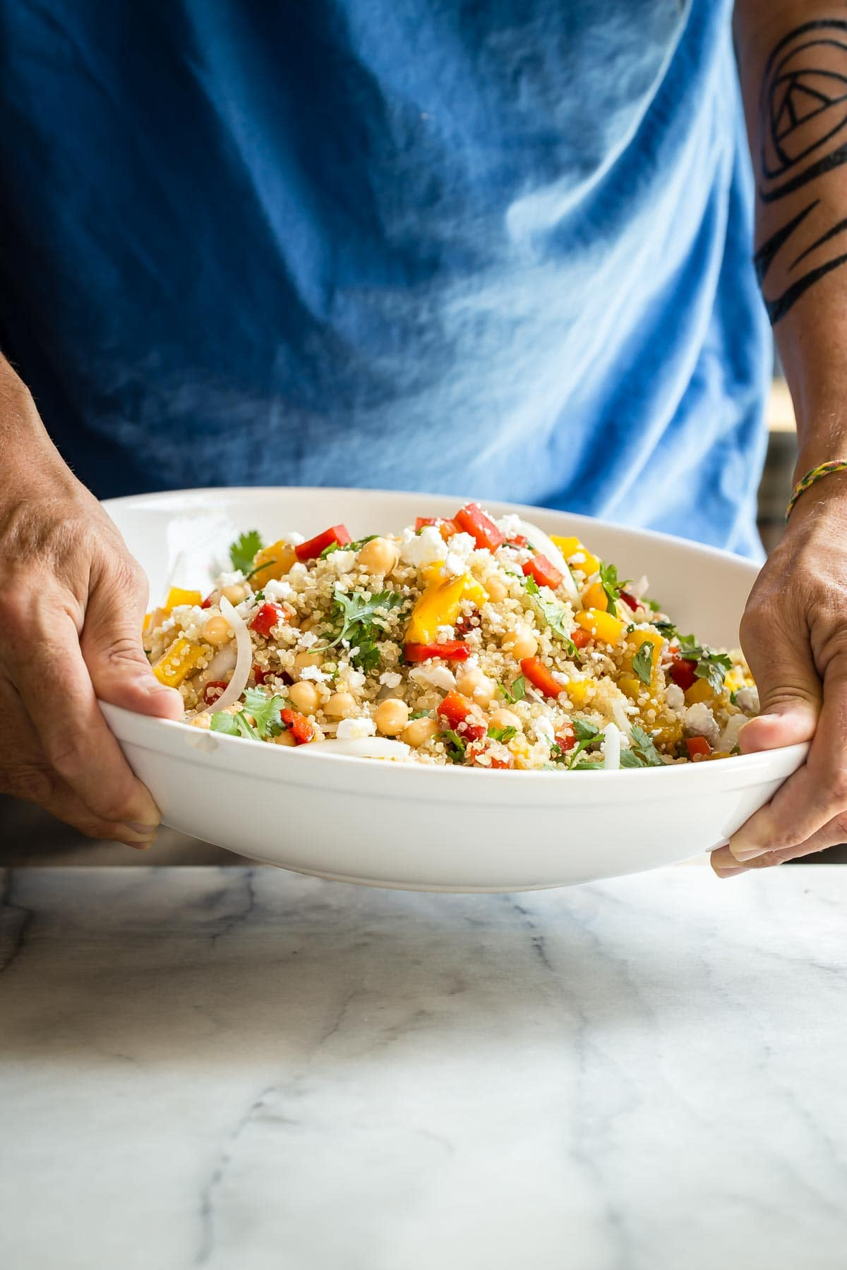 Quinoa salad loaded with vegetables and crumbled feta cheese