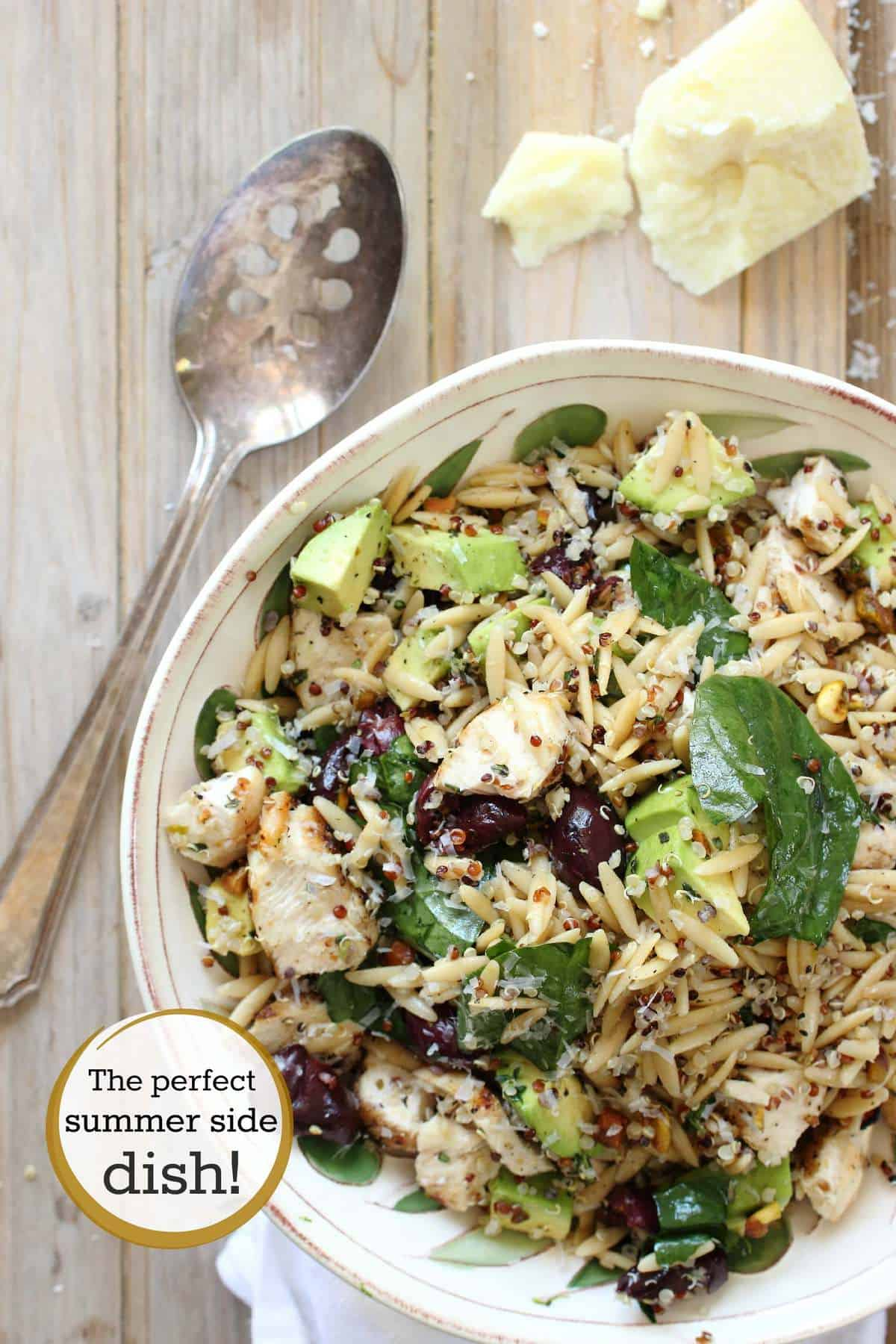 Healthy grilled chicken salad with quinoa and orzo pasta quinoa orzo and grilled chicken mixed with spinach and avocado forumfinder Images