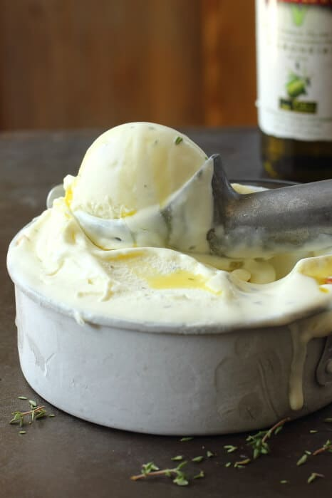 Creamy Pompeian olive oil ice cream mixed with fresh chopped thyme