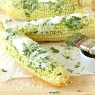 Juicy yellow corn covered in a cilantro infused chimmichuri sauce and drenched in butter