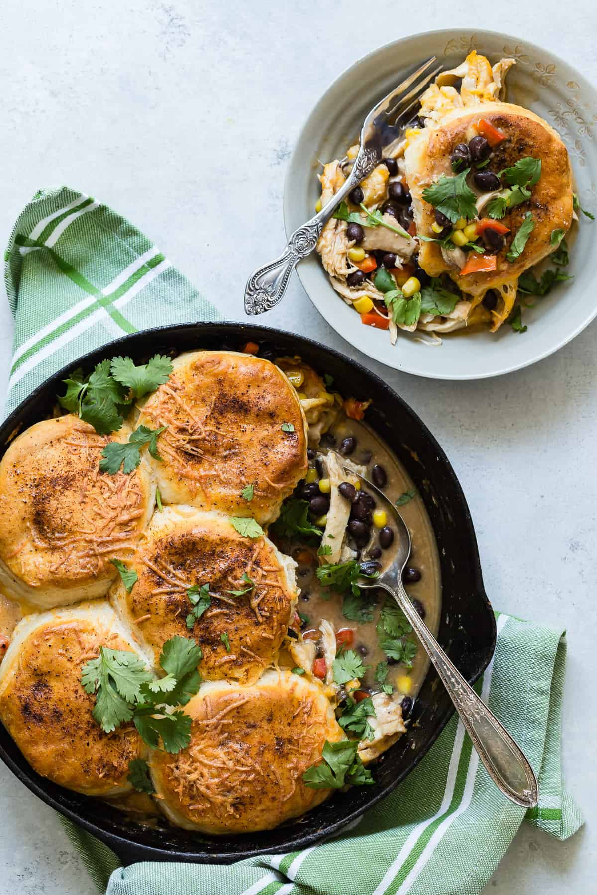 Southwestern chicken pot pie in a skillet and served in a bowl.