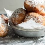 Warm beignets dusted with powdered sugar