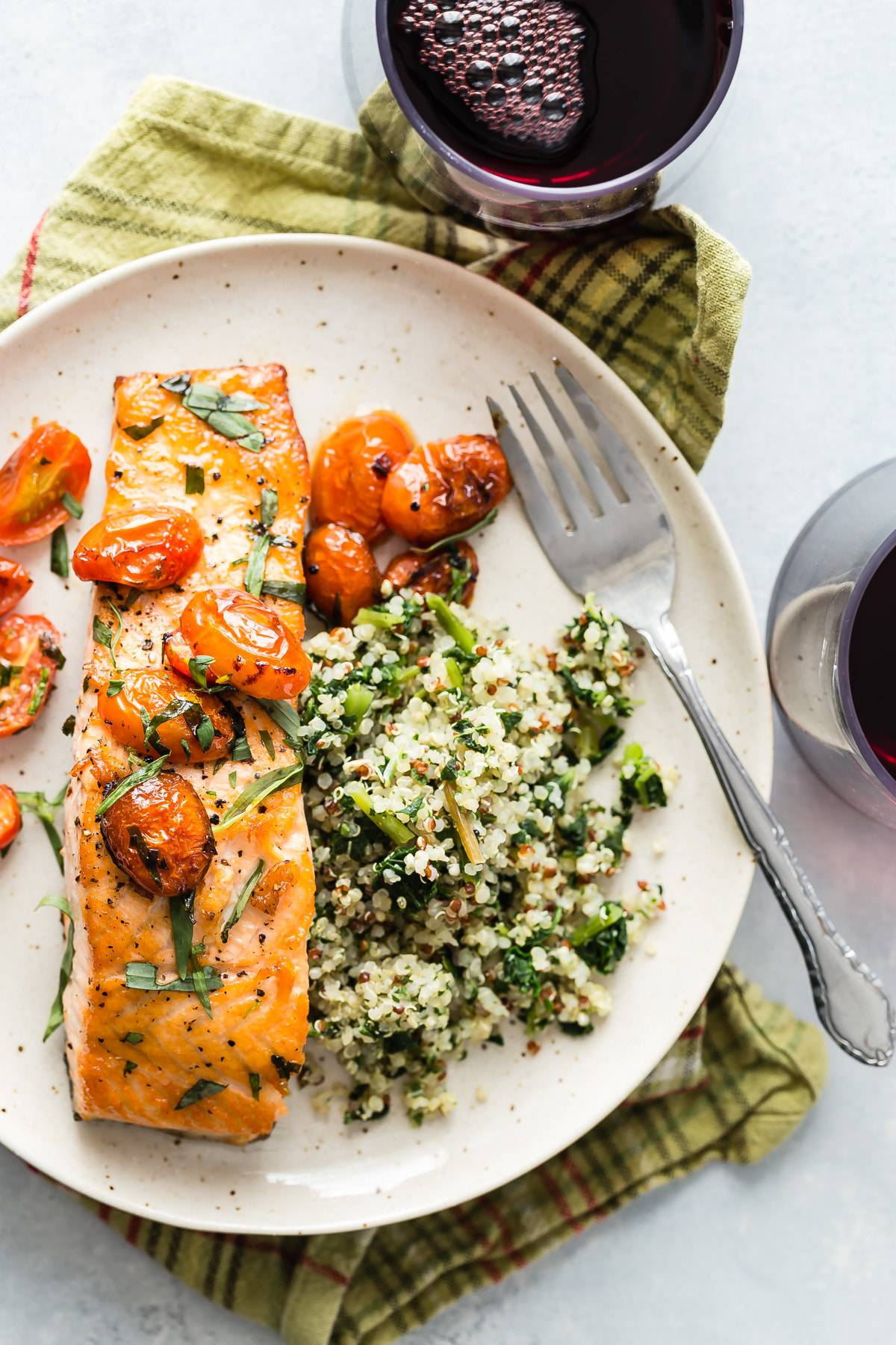 seared salmon on a plate with cherry tomatoes