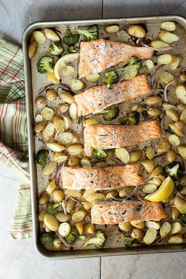 A one pan baked salmon meal roasted in the oven with baby potatoes