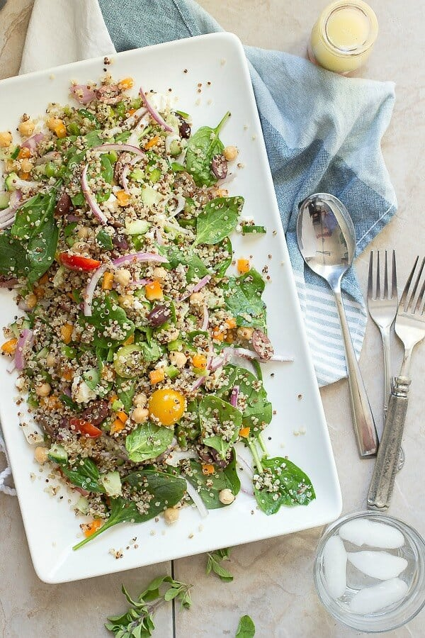 Quinoa salad with fresh baby spinach leaves and tossed with a red wine garlic vinaigrette