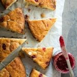 Tasty coffee cake with white chocolate and thick raspberry preserves