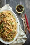 Pasta noodles with chicken and dressed in a tamari and brown rice vinegar dressing
