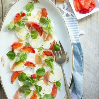 A blood orange salad with Italian prosciutto and creamy mozzarella
