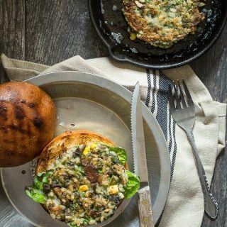 A tasty veggie burger full of broccoli, brown rice and mushrooms