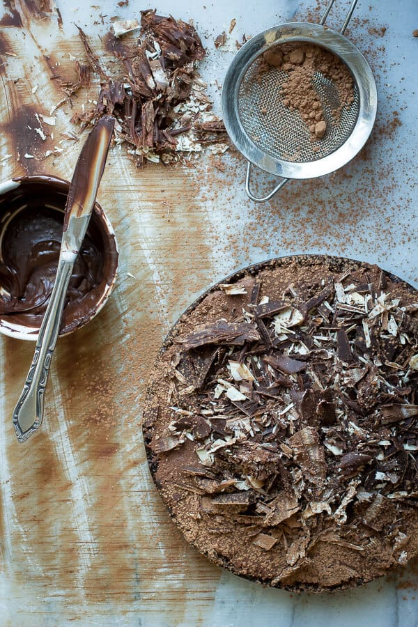 A rich chocolate mousse tart with two kinds of chocolate shavings on top - Foodness Gracious