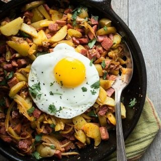 Corned beef hash with onion, cilantro and a soft egg
