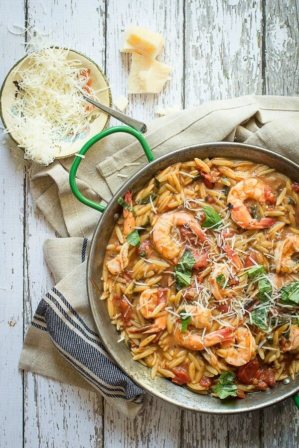 Giant shrimp cooked in a tomato ad chicken broth and served with orzo pasta