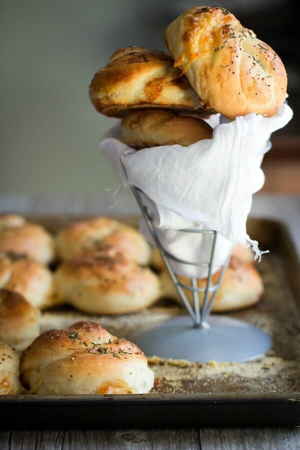 Soft and chewy cheese dinner rolls with sea salt and rosemary