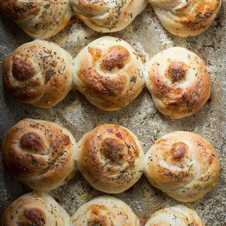 Cheesy bread rolls covered on sea salt and fresh rosemary