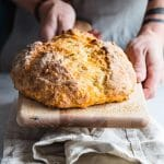 Irish soda bread on wooden cutting board