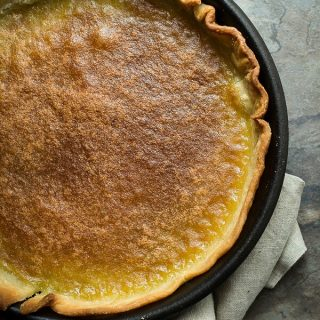 A sweet lemon tart baked in a pastry crust
