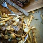 French fries covered in steak, cheese curds and beef gravy