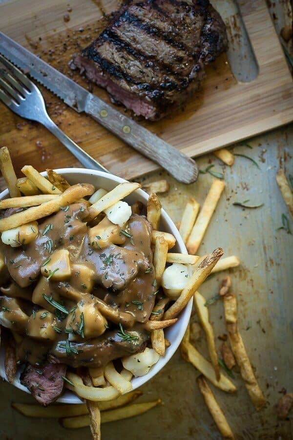 French fries covered in steak, cheese curds and beef gravy. Poutine is the best!