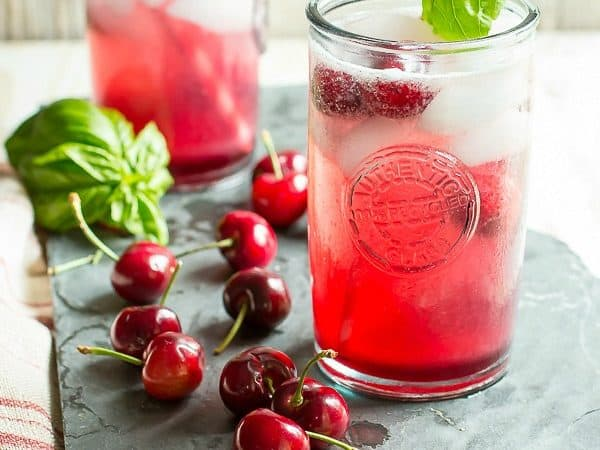 Homemade cherry soda with fresh basil
