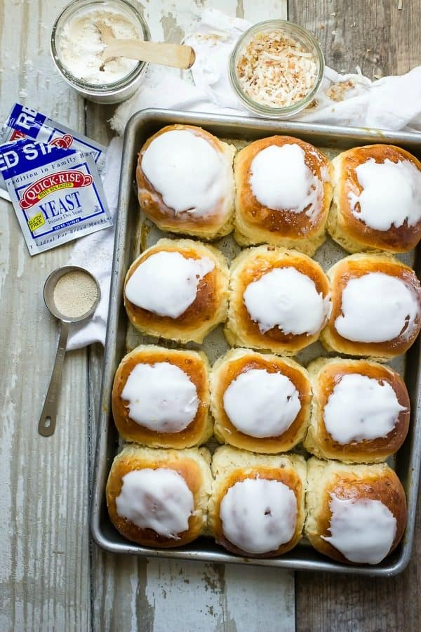 Soft and fluffy coconut buns with a sweet icing on top