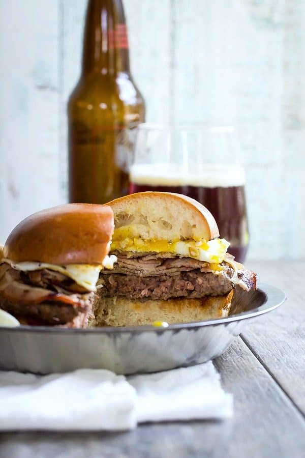 A juicy thick beef patty topped with sliced porchetta and a runny egg