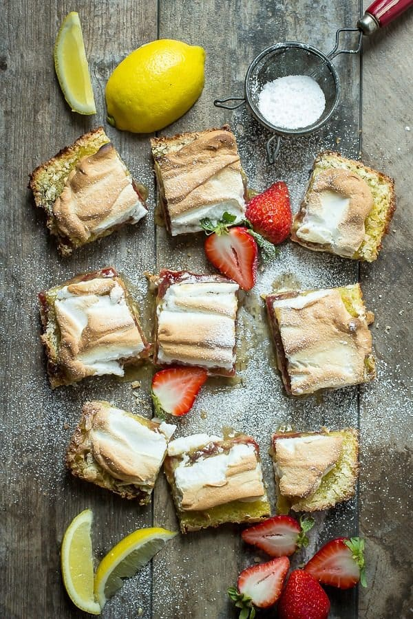 Delicious and fresh lemon bars with a strawberry jelly layer and soft meringue topping