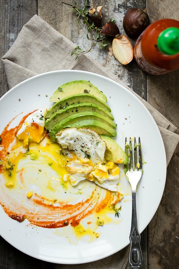 Creamy avocado with a soft runny egg on top