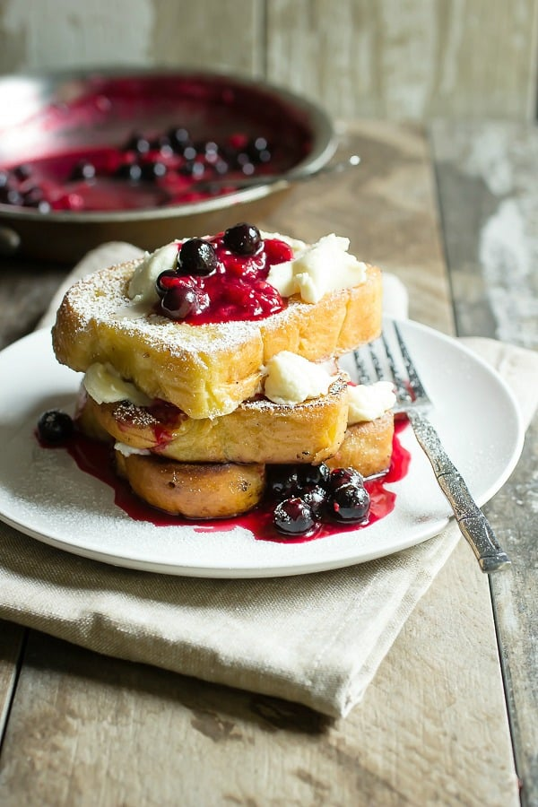 Brioche topped with mascarpone cheese and mixed berry compote