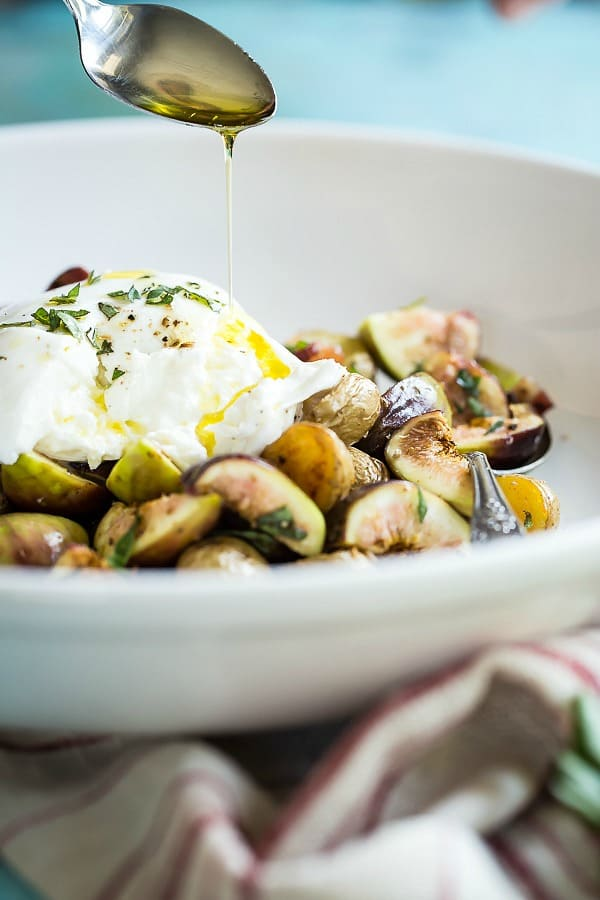 A summer salad of fresh figs, roasted potatoes and burrata cheese