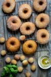 A fried savory donut with basil pesto hummus and mozzarella cheese