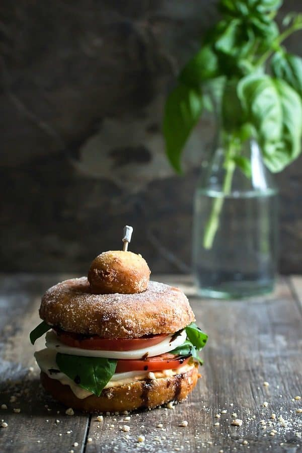 Fried basil and pesto donut with mozzarella and tomato