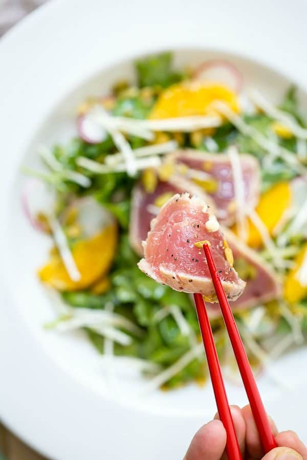Fresh ahi mixed with greens, orange, spicy pipettes and enoki mushrooms