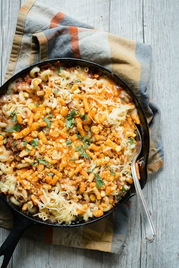 Rich beef chili with a cheesy macaroni pasta and crunchy cheese puff topping