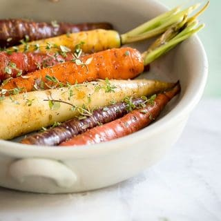 Roasted rainbow carrots with thyme and served with a poached egg