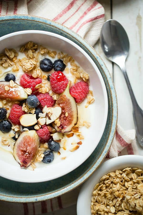 Creamy vanilla yogurt with crunchy granola and fresh berries