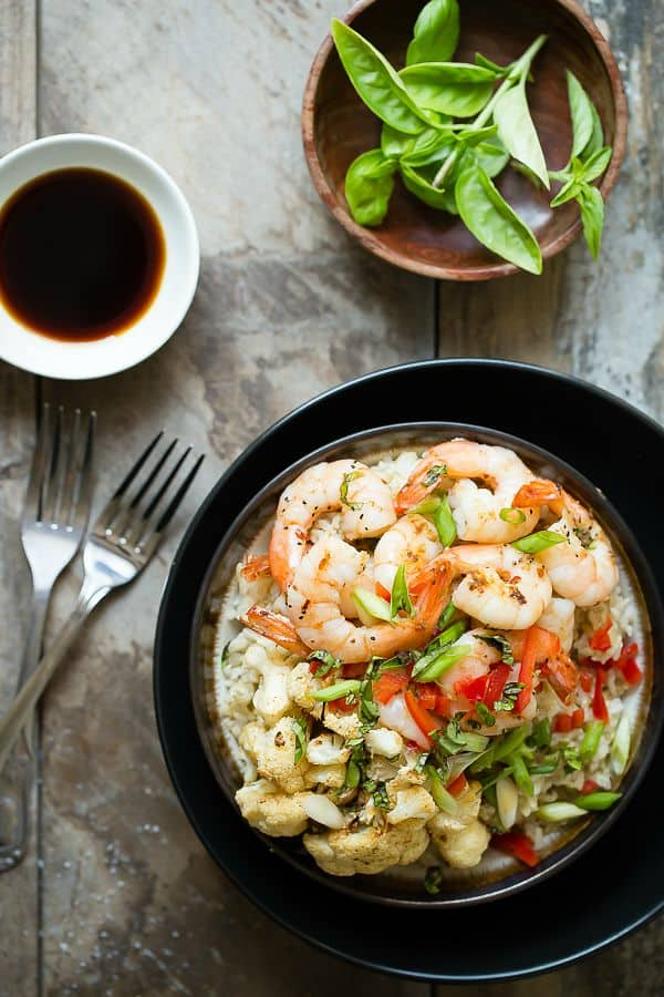 A healthy rice bowl full of shrimp and roasted cauliflower