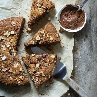 Banana bread topped with a crunchy hazelnut and brown sugar topping