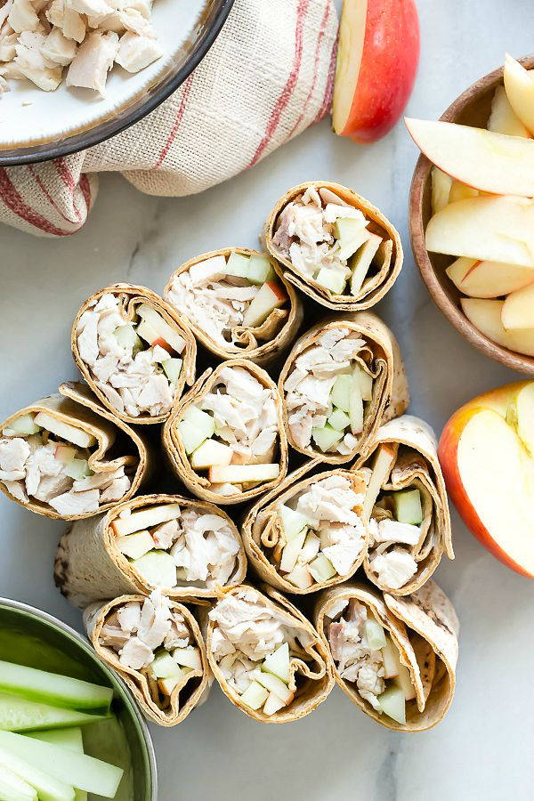 Fresh chicken wraps with cucumber and apple slices wrapped in a Italian herb wrap
