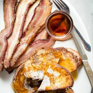 French toast with maple syrup and thick sliced bacon
