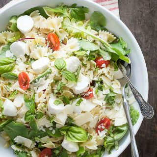 Fresh basil and greens in a tomato and mozzarella salad